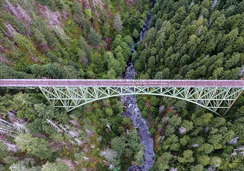 Aerial view of bridge over river in a canyon