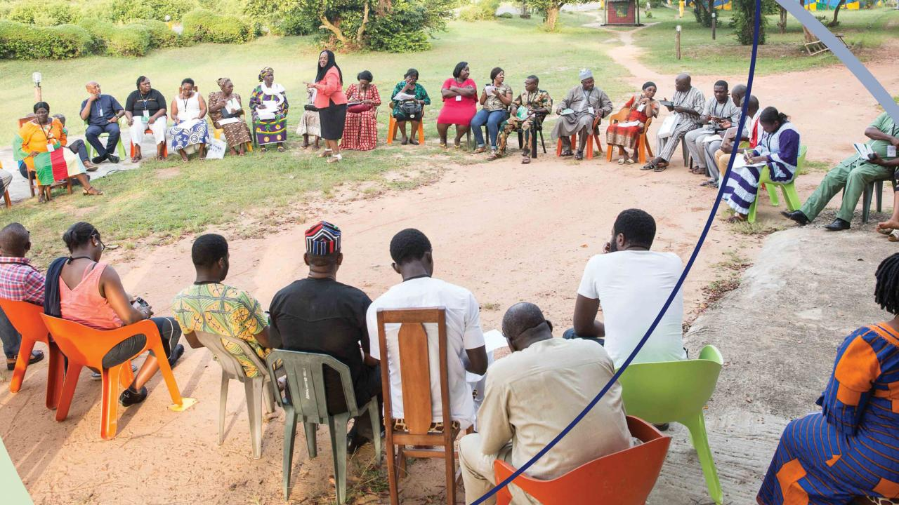 Participants workshop in Nigeria sitting in large circle outside